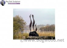 Family of herons in bog oak by Michael Casey