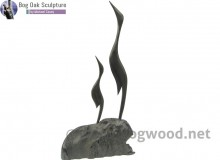 Family of Two Herons in bog oak by Michael Casey